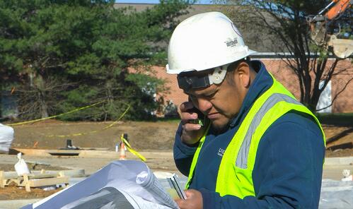 live-green-landscaping-worker-phone-blueprint