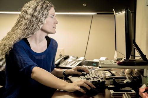 T. Lake Environmental employee at computer