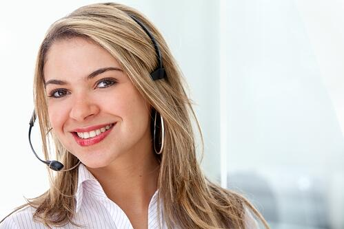 Customer support operator smiling in an office.jpeg