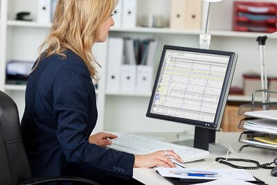 Accounting employee using computer at office desk